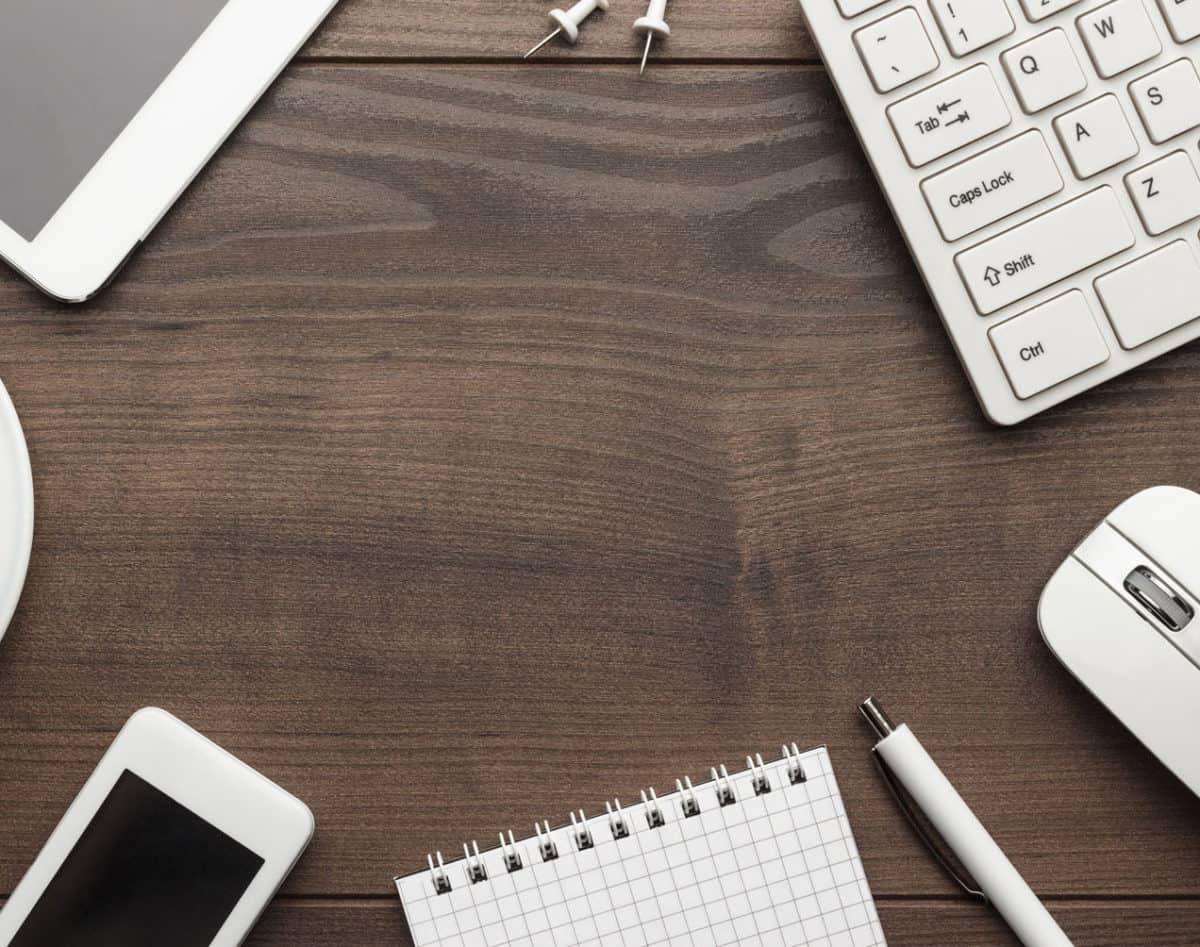 keyboard ipad iphone notebook on a desk