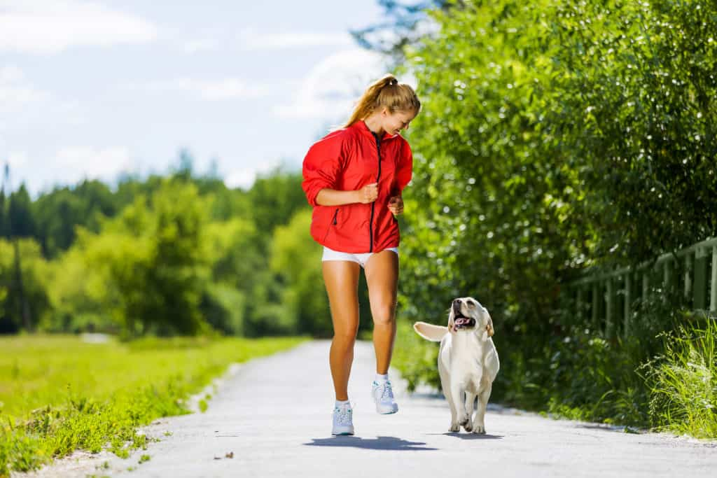 Sport Girl Running with Dog