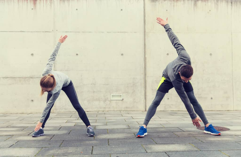 fitness, sport, exercising, training and people concept - couple